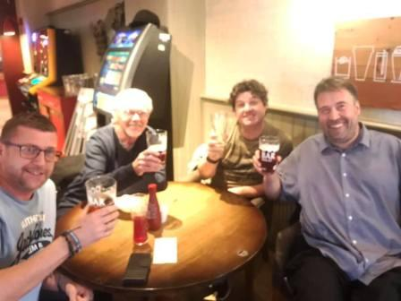 The band raising a glass to Liam for his birthday