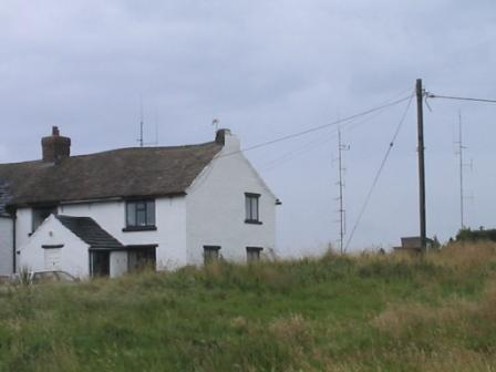 Farmhouse at Bowstonegate, with repeater masts behind
