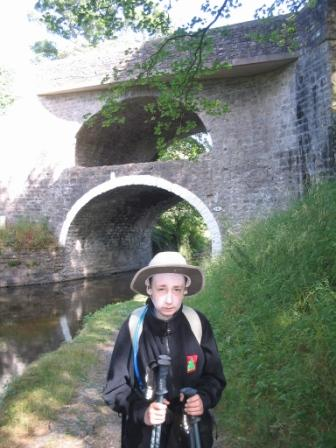 Jimmy by the double-arched bridge