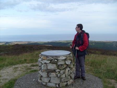 Jimmy on the summit, with a great view over the Moray Firth