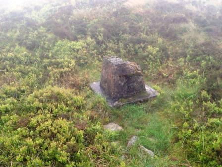 The base of the damaged trig point