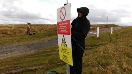 Jimmy setting up by the warning sign!