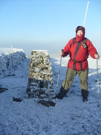 Tom by the trig point en route to the summit