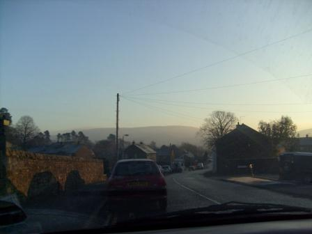 Looking ahead to the hill while driving through Sedburgh