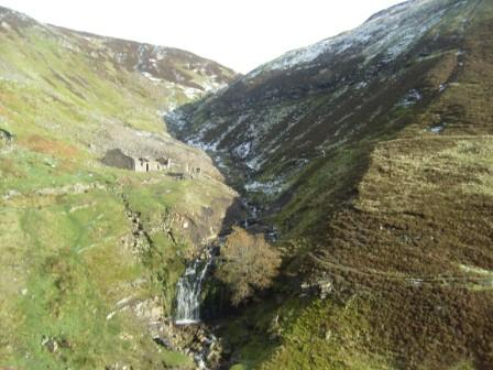 Approach to the summit plateau; lunch was taken in the ruined building to the left of the waterfalls