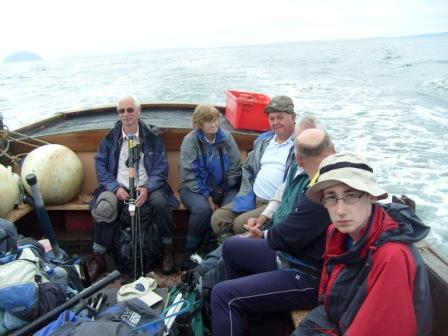 The SOTA activating team looking tired on the return boat journey!